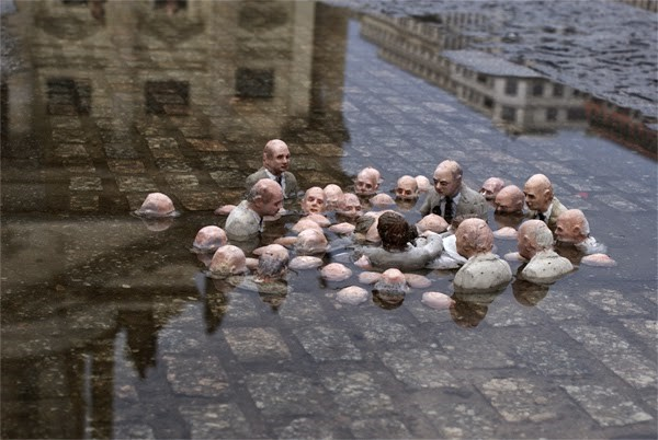 Follow the leader- Street art by Isaac Cordal
